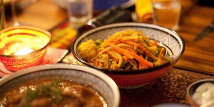 Et vanlig måltid i Johannesburg – gryteretter av ulike typer som serveres med rotgrønnsaker.