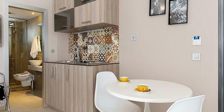 Kjøkkenkrok og spiseplass i en ettromsleilighet