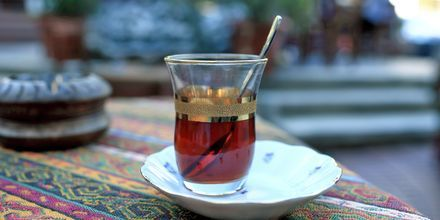 Et glass te, på lokal manér